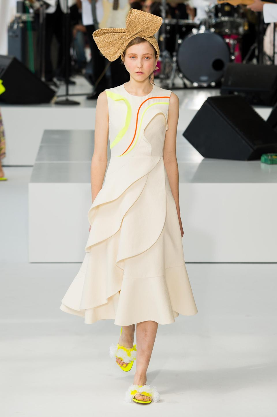 <p><i>Model wears white, A-line dress with yellow-and-orange stitching from the SS18 Delpozo collection. (Photo: IMAXtree) </i></p>