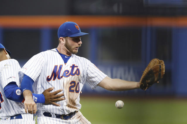 New York Mets first baseman Pete Alonso (20) drops the ball as he collides with second baseman Robinson Cano left, while trying to catch a ball hit by New York Yankees' DJ LeMahieu during the fifth inning of a baseball game Wednesday, July 3, 2019, in New York. Alonso was charged with an error. (AP Photo/Kathy Willens)