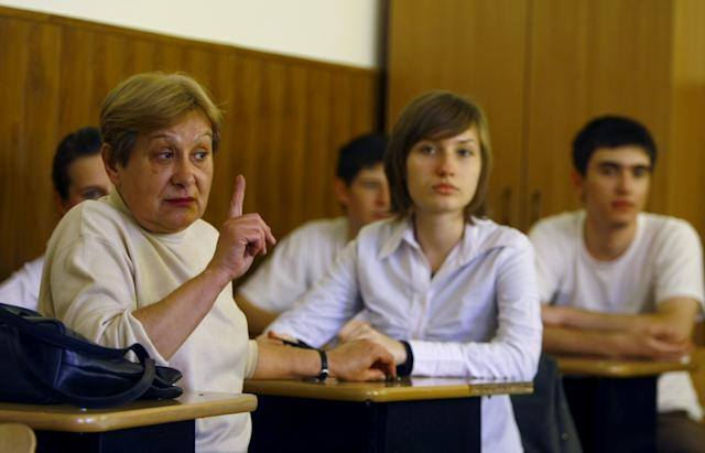 Teacher and students in a Romanian school