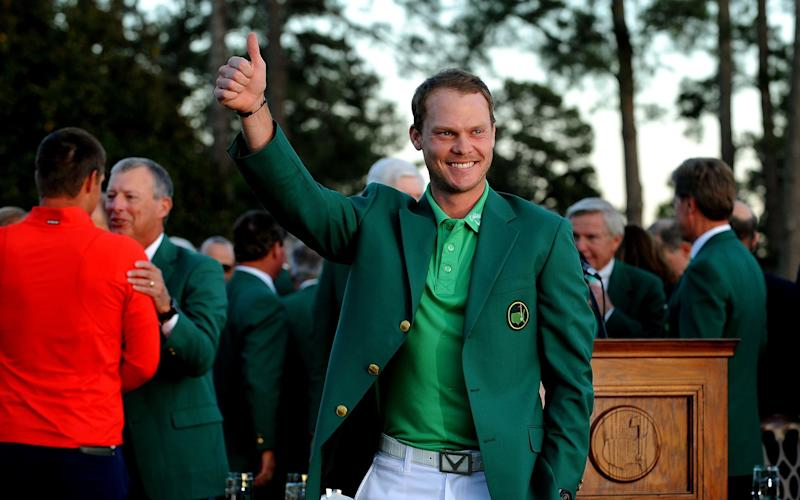 Danny Willett claimed the green jacket in 2016 - REX
