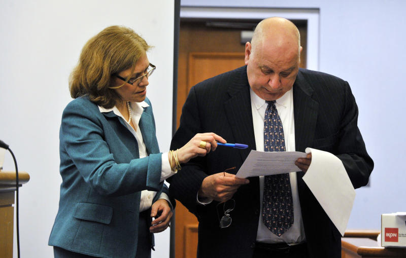 Assistant State's Attorney Susann Gill, left, and Hubert Santos, Michael Skakel's lead defense attorney, confer about admitting evidence at Skakel's habeas corpus hearing at State Superior Court in Vernon, Conn., on Wednesday, April 17, 2013. (AP Photo/The Stamford Advocate, Jason Rearick, Pool)