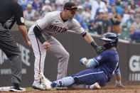 Arizona Diamondbacks shortstop Nick Ahmed tags out Chicago Cubs' Nico Hoerner, right, at second base after Hoerner hit a two-run single during the third inning of a baseball game in Chicago, Friday, July 23, 2021. (AP Photo/Nam Y. Huh)