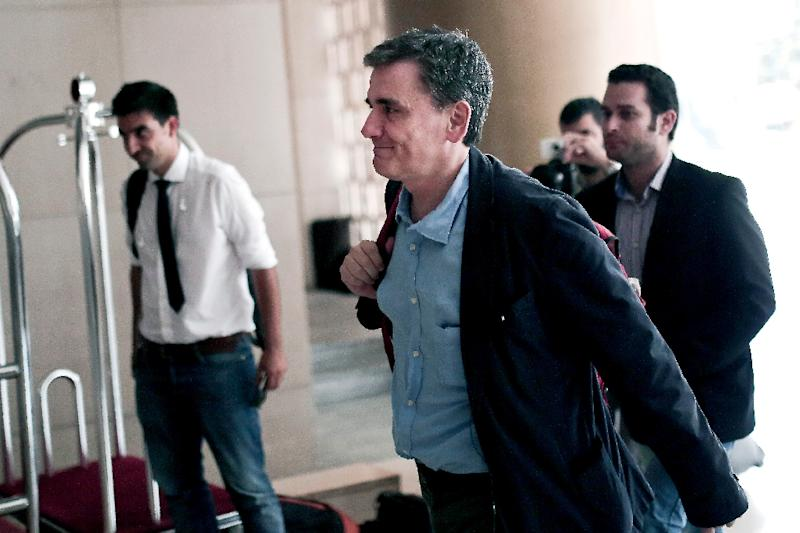 Greek Finance Minister Euclid Tsakalotos arrives for a meeting with representatives of the International Monetary Fund, at a hotel in Athens, on August 9, 2015 (AFP Photo/Angelos Tzortzinis)