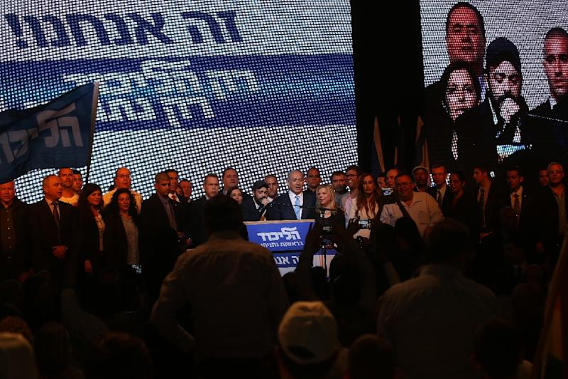 Israeli Prime Minister Benjamin Netanyahu next to Likud Party leaders after exit poll figures in Israel's parliamentary elections late on March 17, 2015 in the city of Tel Aviv (AFP Photo/Menahem Kahana)