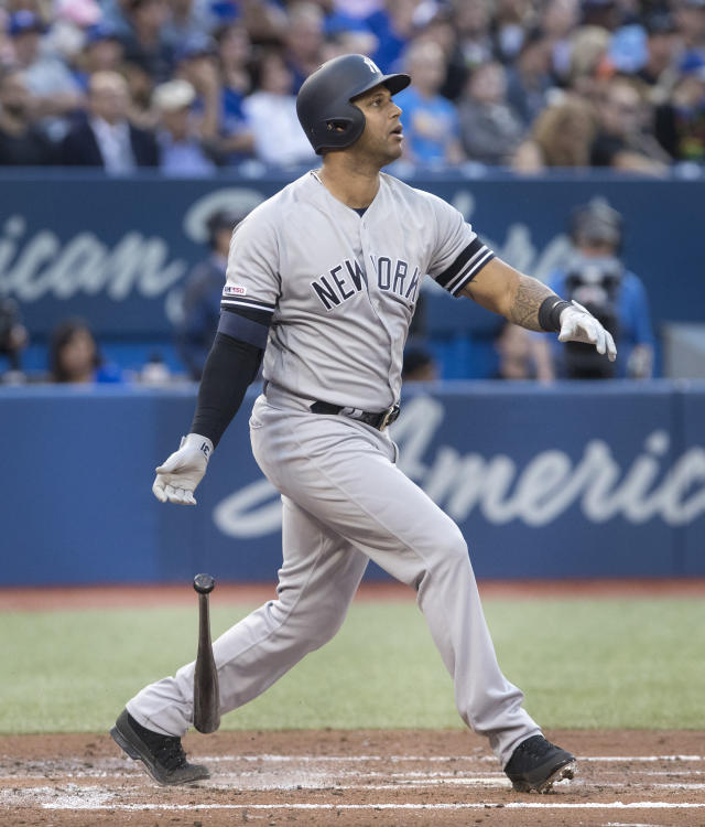 New York Yankees' Aaron Hicks watches his three-run home run against the Toronto Blue Jays during the second inning of a baseball game Thursday, June 6, 2019, in Toronto. (Fred Thornhill/The Canadian Press via AP)