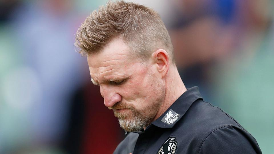 Pictured here, Nathan Buckley looks disappointed after a Collingwood game.