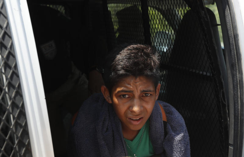 A Central American migrant detained by Mexican immigration agents looks out from a van on the highway to Pijijiapan, Mexico, Monday, April 22, 2019. Mexican police and immigration agents detained hundreds of Central American migrants on Monday, the largest single raid on a migrant caravan since the groups started moving through Mexico last year. (AP Photo/Moises Castillo)