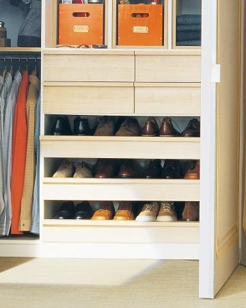 """<div class=""""caption-credit""""> Photo by: Martha Stewart Living</div><b>Orderly Shoe Racks</b> <br> Open, pull-out shelves provide an orderly home for men's or other flat footwear. Each shelf is deep enough to accommodate two rows of shoes, so no stand-alone racks are needed. <br> <b>Related:</b> <br> <b><a href=""""http://www.marthastewart.com/275539/bedroom-decorating-ideas/@center/277006/bedroom-and-bathroom-decorating?xsc=synd_yshine"""" rel=""""nofollow noopener"""" target=""""_blank"""" data-ylk=""""slk:23 Ways to Decorate Your Bedroom"""" class=""""link rapid-noclick-resp"""">23 Ways to Decorate Your Bedroom</a> <br> <a href=""""http://www.marthastewart.com/275280/bathroom-organization-tips/@center/277006/bedroom-and-bathroom-decorating?xsc=synd_yshine"""" rel=""""nofollow noopener"""" target=""""_blank"""" data-ylk=""""slk:24 Ways to Organize Your Bathroom"""" class=""""link rapid-noclick-resp"""">24 Ways to Organize Your Bathroom</a></b> <br>"""