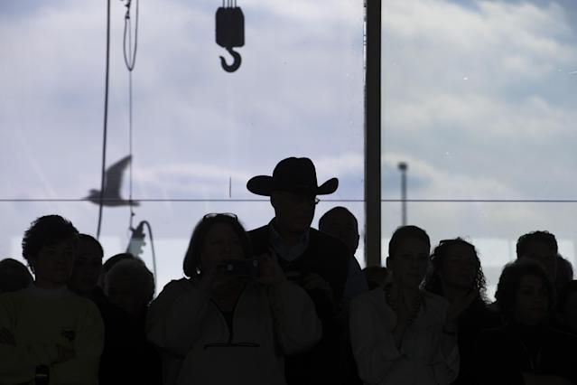 Spectators watch a competition at Pier 92 during the Westminster Kennel Club dog show, Monday, Feb. 10, 2014, in New York. (AP Photo/John Minchillo)