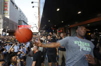 NBA star Kobe Bryant throws a ball to his fans during a promotional event in a shopping district in China's southern city of Shenzhen, Sunday Aug. 4, 2013. Kobe Bryant visited Shenzhen as part of his China tour. (AP Photo/Kin Cheung)