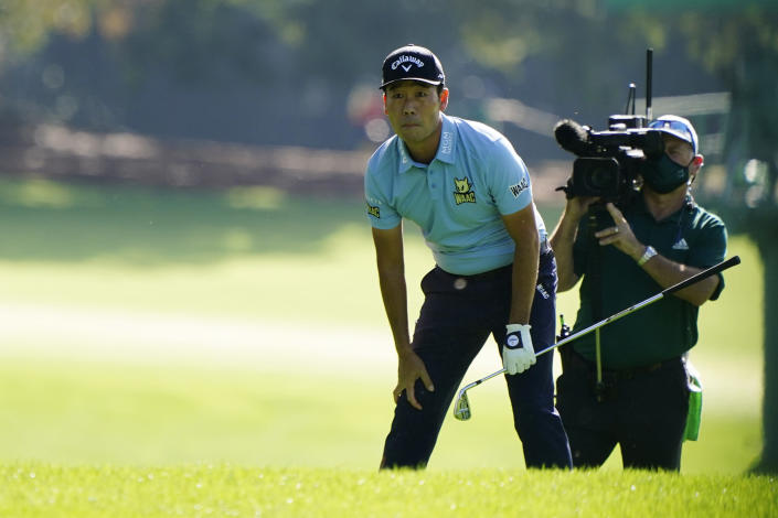 Kevin Na looks after his shot on the first fairway during the first round of the Masters golf tournament Thursday, Nov. 12, 2020, in Augusta, Ga. (AP Photo/Matt Slocum)