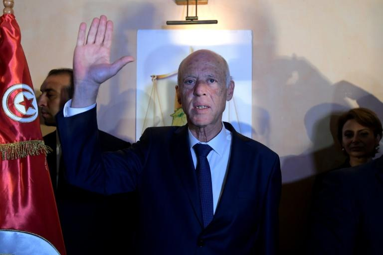 Conservative academic Kais Saied celebrates his victory in the Tunisian presidential election