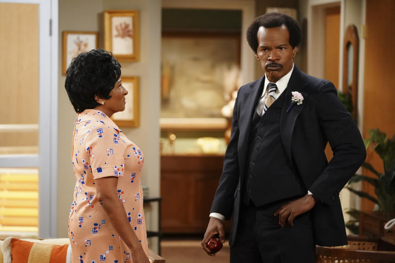 "This image released by ABC shows Wanda Sykes as Louise Jefferson, left, and Jamie Foxx as George Jefferson in ""Live in Front of a Studio Audience: Norman Lear's 'All in the Family' and 'The Jeffersons',"" special which aired on Wednesday, May 22. According to Nielsen figures out Wednesday, May 29, ABC's live re-creation of episodes of ""All in the Family"" and ""The Jeffersons"" ranked among last week's most-watched programs. (Eric McCandless/ABC via AP)"