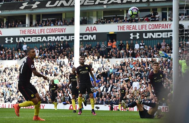 Aleksandar Kolarov (left) watches his attempted clearance bounce into the net at White Hart Lane in London, on October 2, 2016 (AFP Photo/Glyn Kirk)