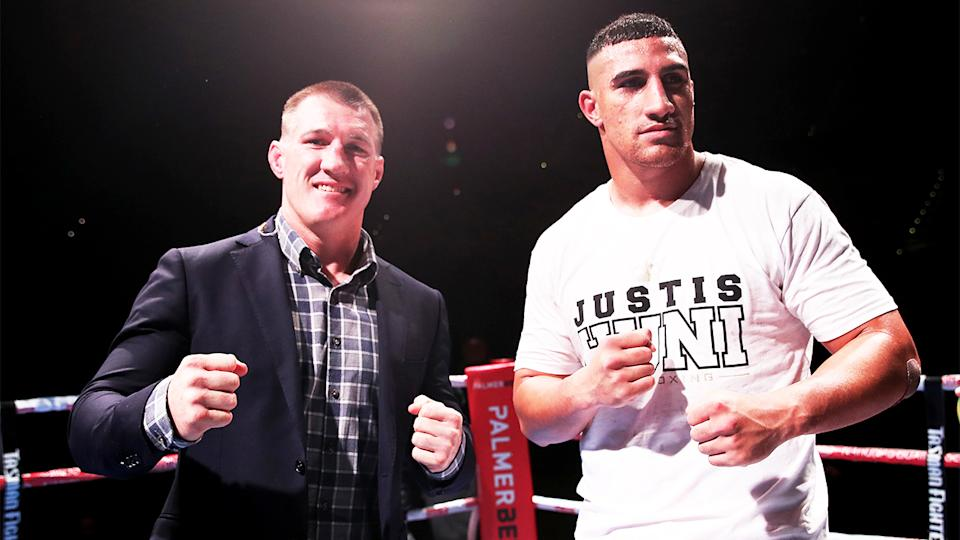 Justis Huni (pictured right) poses next to Paul Gallen (pictured left) in the ring.