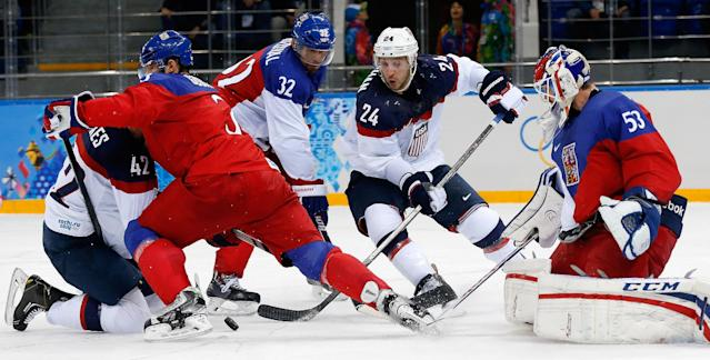 USA forward David Backes (42) and USA forward Ryan Callahan (24) try to gain control of the puck in front of the the Czech Republic goal as Czech Republic defenseman Radko Gudas (3), Czech Republic defenseman Michal Rozsival (32) and Czech Republic goaltender Alexander Salak defend during the second period of men's quarterfinal hockey game in Shayba Arena at the 2014 Winter Olympics, Wednesday, Feb. 19, 2014, in Sochi, Russia. (AP Photo/Petr David Josek)