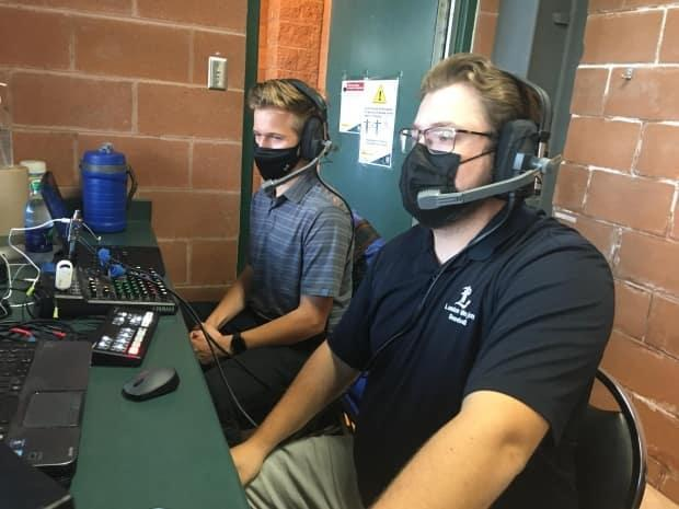 Dylan Baker, left, and Noah Smith handle play-by-play duties for the London Majors games. Smith is a recent graduate of Fanshawe College's radio broadcasting program and Baker is a 15-year-old high-school student.  (Andrew Lupton/CBC - image credit)