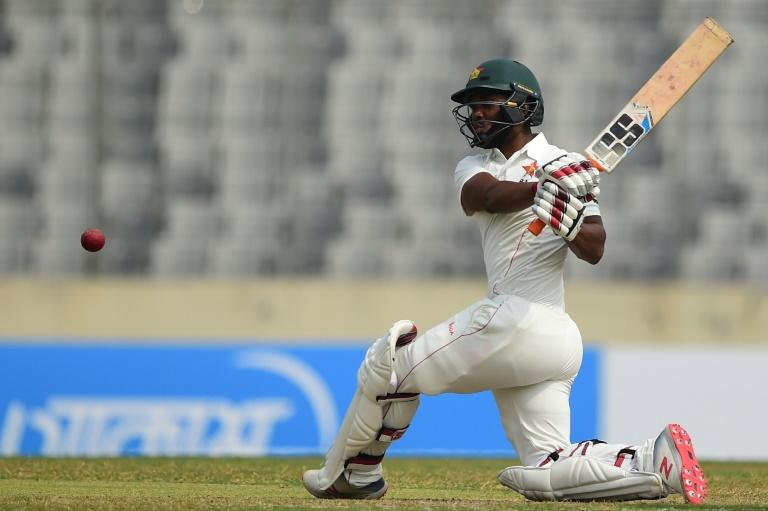 Zimbabwe's Regis Chakabva plays a shot during the second day of the first Test (AFP Photo/MUNIR UZ ZAMAN)