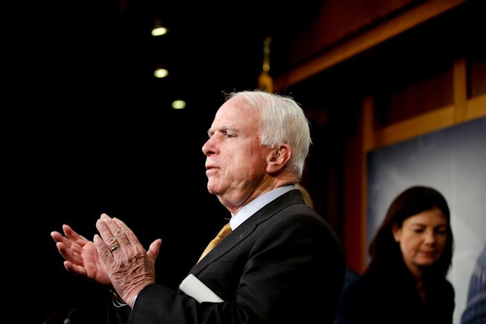 Senate Armed Services Committee Chairman Sen. John McCain (R-Ariz.) applauds the final comments from fellow committee member, Sen. Lindsey Graham (R-S.C.), as they conclude a news conference on Capitol Hill in Washington on March 26, 2015, to discuss the situation in Yemen. Sen. Kelly Ayotte (R-N.H.) is at right.
