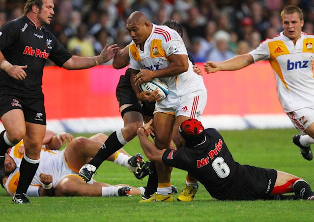 New Zealand Waikato Chiefs' Arizona Taumalolo (C) is tackled by Durban Sharks' players during a Super 15 rugby union match at the Mr Price Kings Park Rugby Stadium on April 21, 2012. AFP PHOTO (Photo credit should read -/AFP/Getty Images)