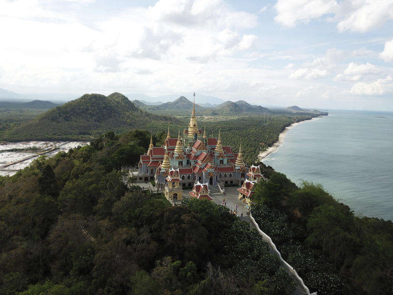 This June 15, 2019 photo shows Wat Tang Sai, a Buddhist temple perched atop Thong Chai Mountain in Ban Krut in the Prachuap Khiri Khan province of Thailand. You won't find the party scene of Phuket or Pattaya in laid-back Ban Krut, but you will get one of the cleanest and quietest stretches of white sand within driving distance of the capital. (AP Photo/Nicole Evatt)