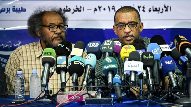 Senior opposition figure Omar el-Digeir (R) said protest leaders were ready to meet with the head of the military council