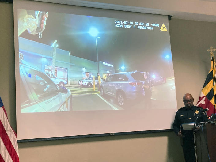 Montgomery County Police Chief Marcus Jones reviews an officers' body camera footage from a fatal police shooting on July 16 at a McDonald's in Gaithersburg, Md., during a news conference in Gaithersburg, Tuesday, July 27, 2021. (AP Photo/Michael Kunzelman)