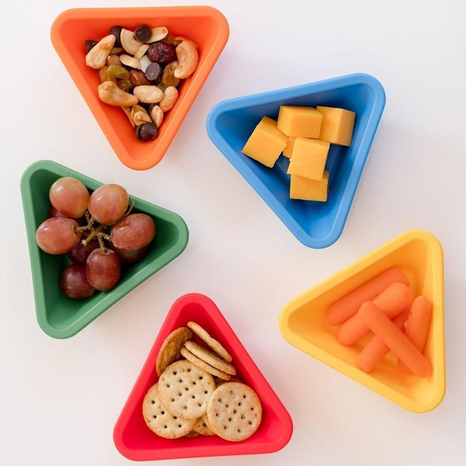 """This cup is designed to give your youngster perfect portions of snacks and sides. These are particularly great as dipping sauce cups because KIDS. LOVE. DIPPING. SAUCE.<br /><br /><strong>Promising review:</strong>""""This is a fantastic idea! Both of my children love them, three years and 10 months!"""" — Janae Roithmayr<br /><br />Get it from<a href=""""https://go.skimresources.com?id=38395X987171&xs=1&url=https%3A%2F%2Fwww.etsy.com%2Fshop%2FLollaland&xcust=HPToddlerMealtime60885fbae4b0ccb91c2ac430"""" target=""""_blank"""" rel=""""noopener noreferrer"""">Lollaland</a>on Etsy for<a href=""""https://go.skimresources.com?id=38395X987171&xs=1&url=https%3A%2F%2Fwww.etsy.com%2Flisting%2F257056068%2Fmealtime-set-dipping-cup-sold&xcust=HPToddlerMealtime60885fbae4b0ccb91c2ac430"""" target=""""_blank"""" rel=""""noopener noreferrer"""">$4</a>(available in seven colors)."""