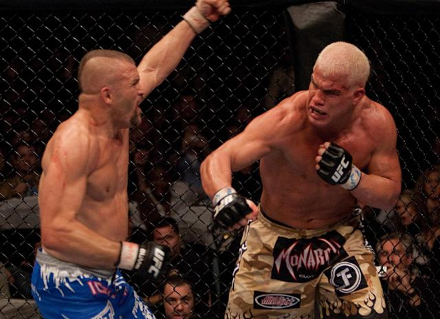(R-L) Tito Ortiz punches Chuck Liddell at UFC 66 at the MGM Grand Garden Arena on Dec. 30, 2006 in Las Vegas. (Getty Images)
