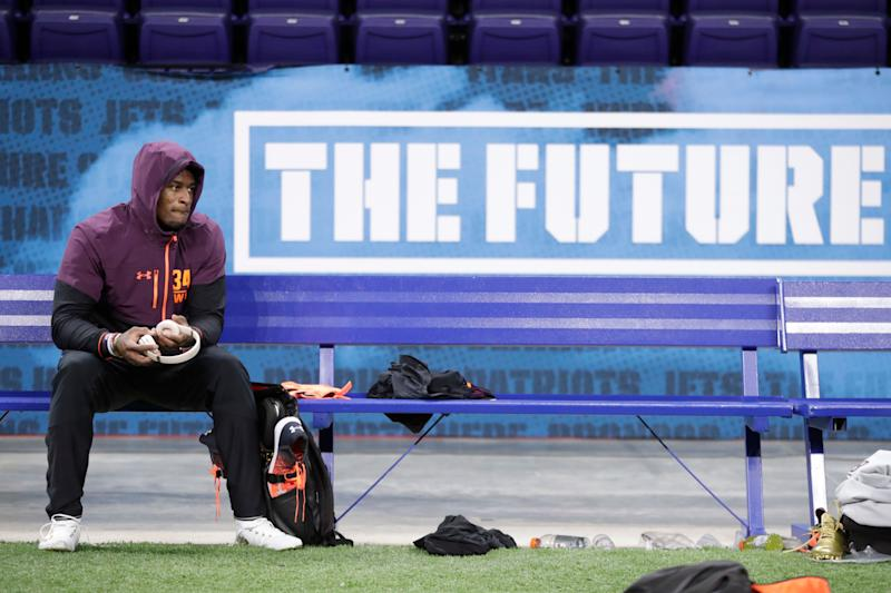 Mississippi wide receiver D.K. Metcalf sits on the bench between drills at the NFL football scouting combine in Indianapolis, Saturday, March 2, 2019. (AP Photo/Michael Conroy)