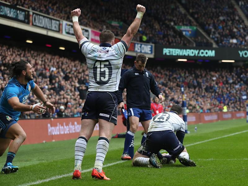 Stuart Hogg celebrates Matt Scott's try: Getty