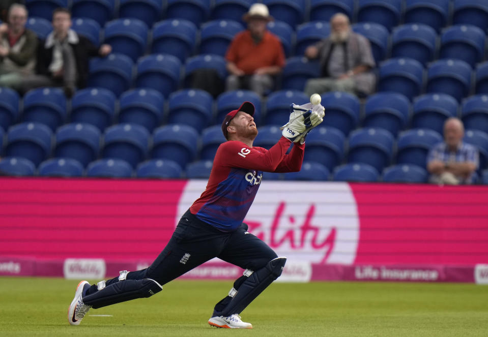 England's Jonny Bairstow takes a catch to dismiss Sri Lanka's Kusal Mendis off the bowling of England's Mark Wood.during the second T20 international cricket match between England and Sri Lanka in Cardiff, Wales, Thursday, June 24, 2021. (AP Photo/Alastair Grant)