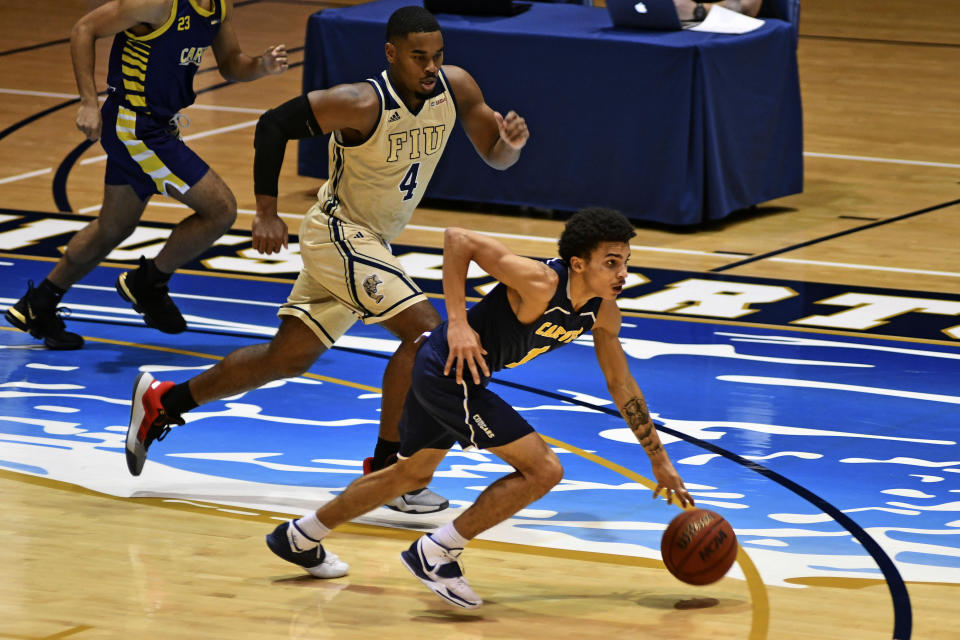 Carver College forward Antwon Ferrell drives the ball down court during the first half of an NCAA college basketball game against Florida International Monday, Dec. 21, 2020, in Miami. (AP Photo/Gaston De Cardenas)