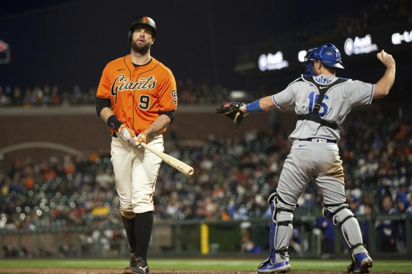 San Francisco Giants' Brandon Belt (9) reacts to striking out during the sixth inning.