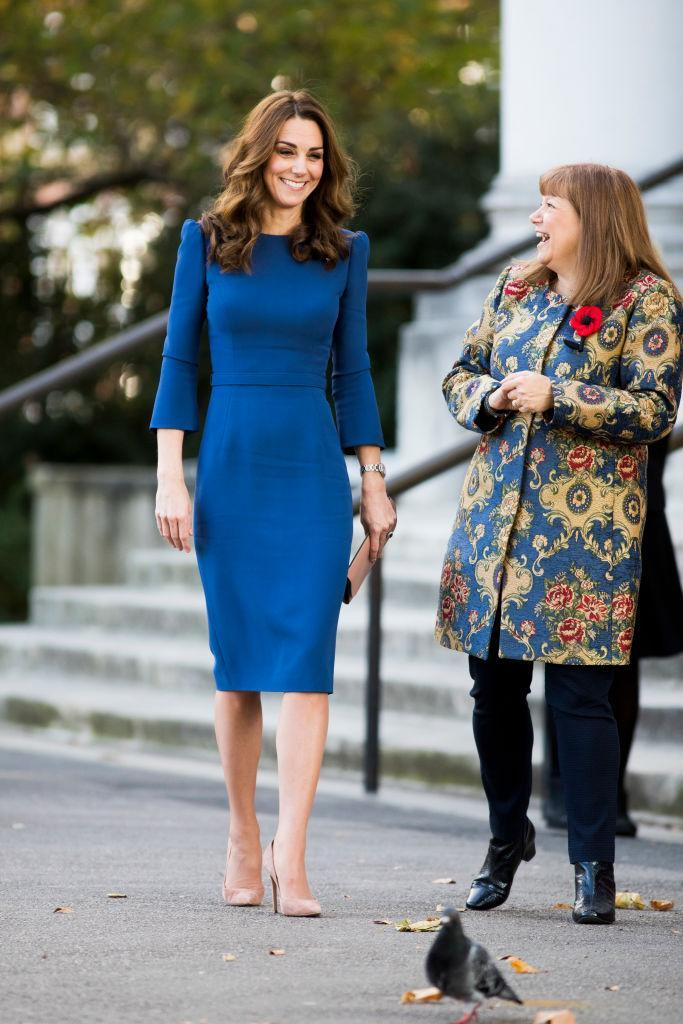 <p>For a trip to the Imperial War Museum on October 31, the Duchess of Cambridge wore a royal blue midi dress by Jenny Packham. <em>[Photo: Getty]</em> </p>