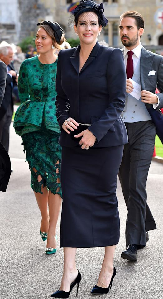 <p>Actress Liv Tyler arrived at St George's Chapel in Windsor wearing a seriously chic navy-hued skirt suit and co-ordinating fascinator. <i>[Photo: Getty]</i> </p>