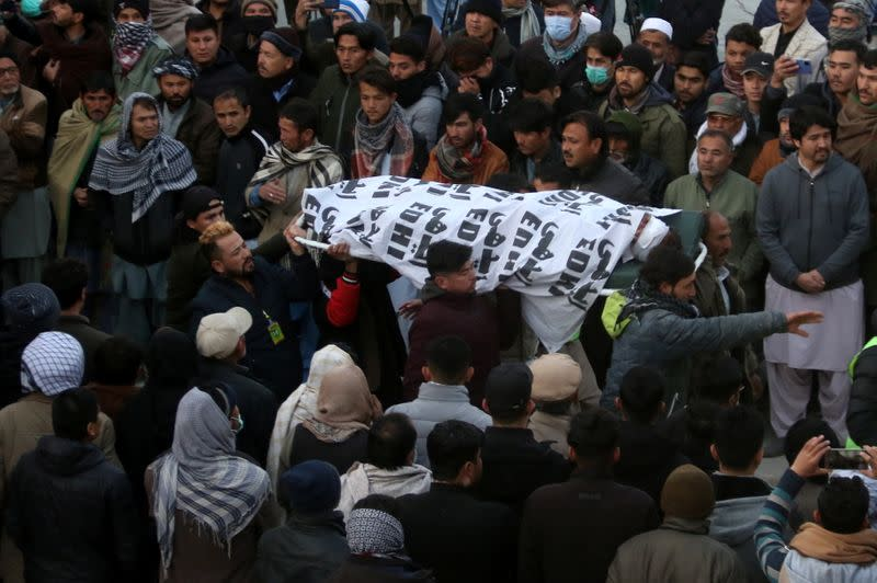People and family members carry a body of their relative, who was a coal miner and got killed along with other coworkers from Pakistan's minority Shi'ite Hazara community by unidentifyed persons in Mach area of Bolan district, in Quetta