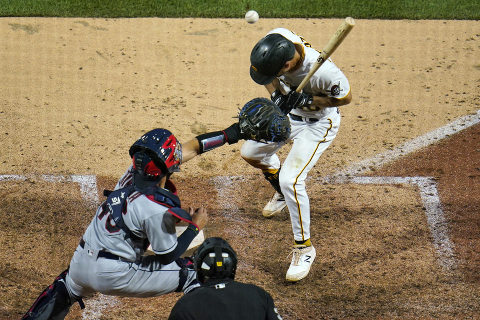 Pittsburgh Pirates' Adam Frazier, right, is hit by a pitch from Cleveland Indians reliever Kyle Nelson, forcing in a run during the sixth inning of a baseball game in Pittsburgh, Friday, June 18, 2021. (AP Photo/Gene J. Puskar)