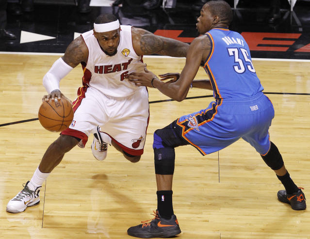 Miami Heat small forward LeBron James (6) drives against Oklahoma City Thunder small forward Kevin Durant (35)during the first half of Game 4 of the NBA Finals basketball series, Tuesday, June 19, 2012, in Miami. (AP Photo/Wilfredo Lee)