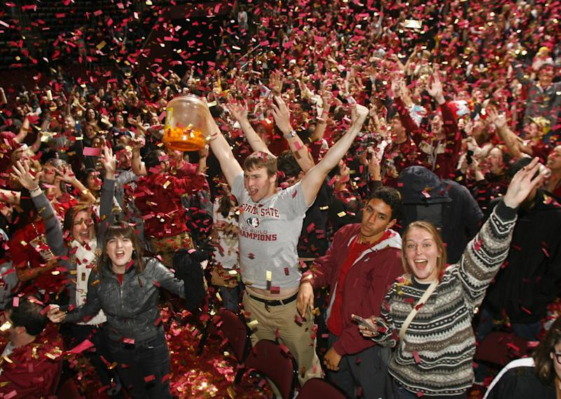 Florida State fans react as confetti rains down on them after watching the BCS Championship football game against Auburn on a 30-foot screen at the Tallahassee Leon County Civic Center on Monday, Jan. 6, 2014, in Tallahassee, Fla. Florida State beat Auburn 34-31. (AP Photo/Phil Sears)