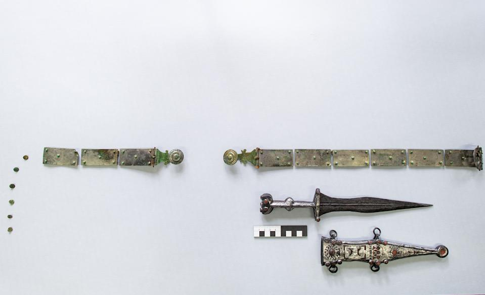 14 February 2020, North Rhine-Westphalia, Münster: A 2000 year old dagger and weapon belt of a legionary lies on a table of the LWL-Archaeology for Westphalia. Archaeologists of the Landschaftsverband Westfalen-Lippe (LWL) present an extraordinary weapon find of a legionary. A rare Roman weapon has been discovered in the Roman burial ground at Haltern am See and has been restored in an elaborate process. It's a dagger with a belt of arms. The experts from the LWL restoration workshop explain how 2000 year old metal and glass were made visible again. Photo: Guido Kirchner/dpa (Photo by Guido Kirchner/picture alliance via Getty Images)