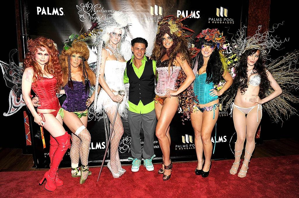 """Over at the Palms, another """"Jersey Shore"""" star, Paul """"DJ Pauly D"""" DelVecchio, made some scantily-clad female friends as he hosted the hotel's Midsummer Night's Dream bash on the same night. The theme for the evening was lingerie, but Pauly D opted to leave his clothes on. Denise Truscello/<a href=""""http://www.wireimage.com"""" target=""""new"""">WireImage.com</a> - August 13, 2011"""