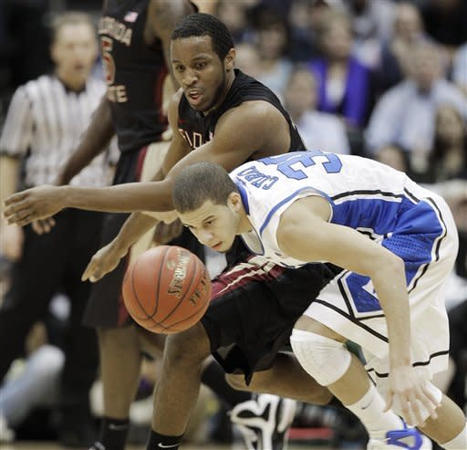 Duke guard Seth Curry (30) and Florida State guard Michael Snaer (21) vie for the ball during the first half of an NCAA college basketball game in the semifinals of the Atlantic Coast Conference tournament, Saturday, March 10, 2012, in Atlanta. (AP Photo/Chuck Burton)