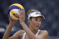 Alix Klineman, of the United States, prepares to serve during a women's beach volleyball match against the Netherlands at the 2020 Summer Olympics, Friday, July 30, 2021, in Tokyo, Japan. (AP Photo/Felipe Dana)