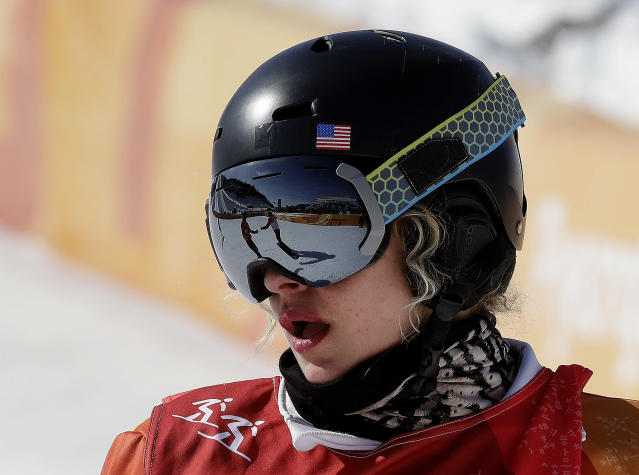 LindseyJacobellis, of the United States, finishes her run during the women's snowboard quarterfinals at Phoenix Snow Park at the 2018 Winter Olympics in Pyeongchang, South Korea, Friday, Feb. 16, 2018. (AP Photo/Lee Jin-man)