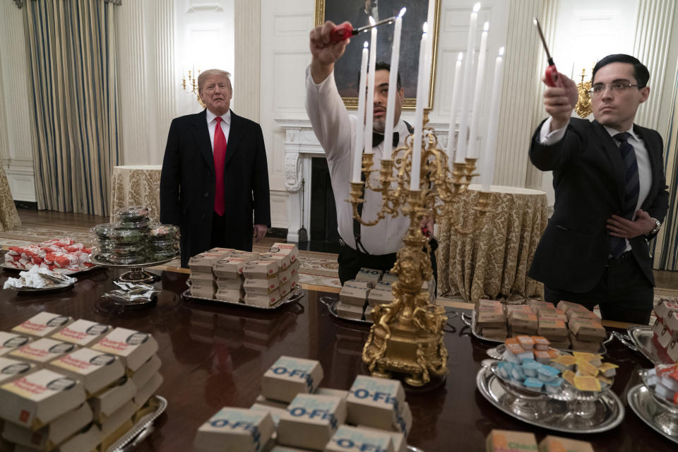 President Donald J. Trump presents fast food to be served to the Clemson Tigers to celebrate their Championship at the White House. (Chris Kleponis / Polaris)