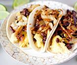 """<p>These breakfast tacos feature eggs, black beans and perfectly caramelized onions. Despite their name, this recipe is one of <a href=""""https://www.thedailymeal.com/cook/every-taco-recipe-youll-ever-need-slideshow?referrer=yahoo&category=beauty_food&include_utm=1&utm_medium=referral&utm_source=yahoo&utm_campaign=feed"""" rel=""""nofollow noopener"""" target=""""_blank"""" data-ylk=""""slk:the best tacos for any time of day"""" class=""""link rapid-noclick-resp"""">the best tacos for any time of day</a>.</p> <p><a href=""""https://www.thedailymeal.com/best-recipes/sweet-chili-caramelized-onion-breakfast-tacos?referrer=yahoo&category=beauty_food&include_utm=1&utm_medium=referral&utm_source=yahoo&utm_campaign=feed"""" rel=""""nofollow noopener"""" target=""""_blank"""" data-ylk=""""slk:For the Caramelized Onion Breakfast Tacos recipe, click here."""" class=""""link rapid-noclick-resp"""">For the Caramelized Onion Breakfast Tacos recipe, click here.</a></p>"""