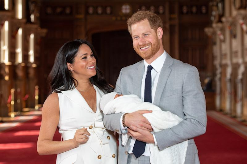 Meghan Markle and Prince Harry with their son, Archie, during a photocall in St George's Hall at Windsor Castle in Berkshire