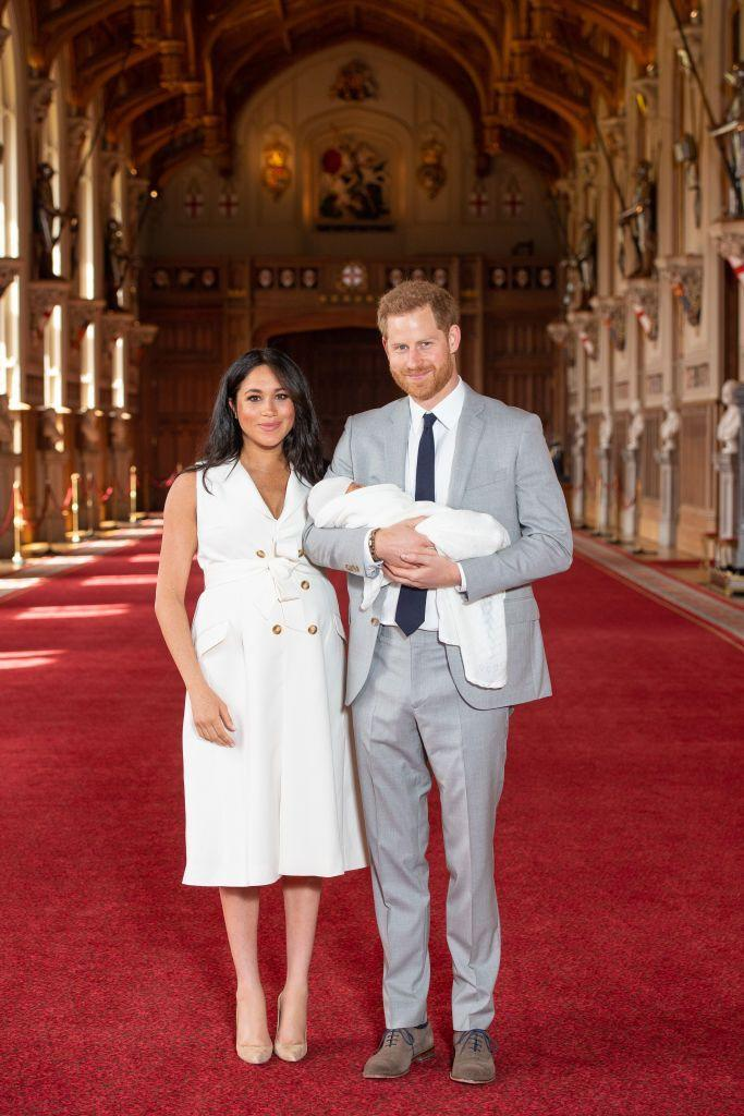 <p>The Duchess of Sussex introduced her new baby to the world wearing a white dress and nude heels. She paired the look with a dainty necklace and chose to wear her hair down. </p>