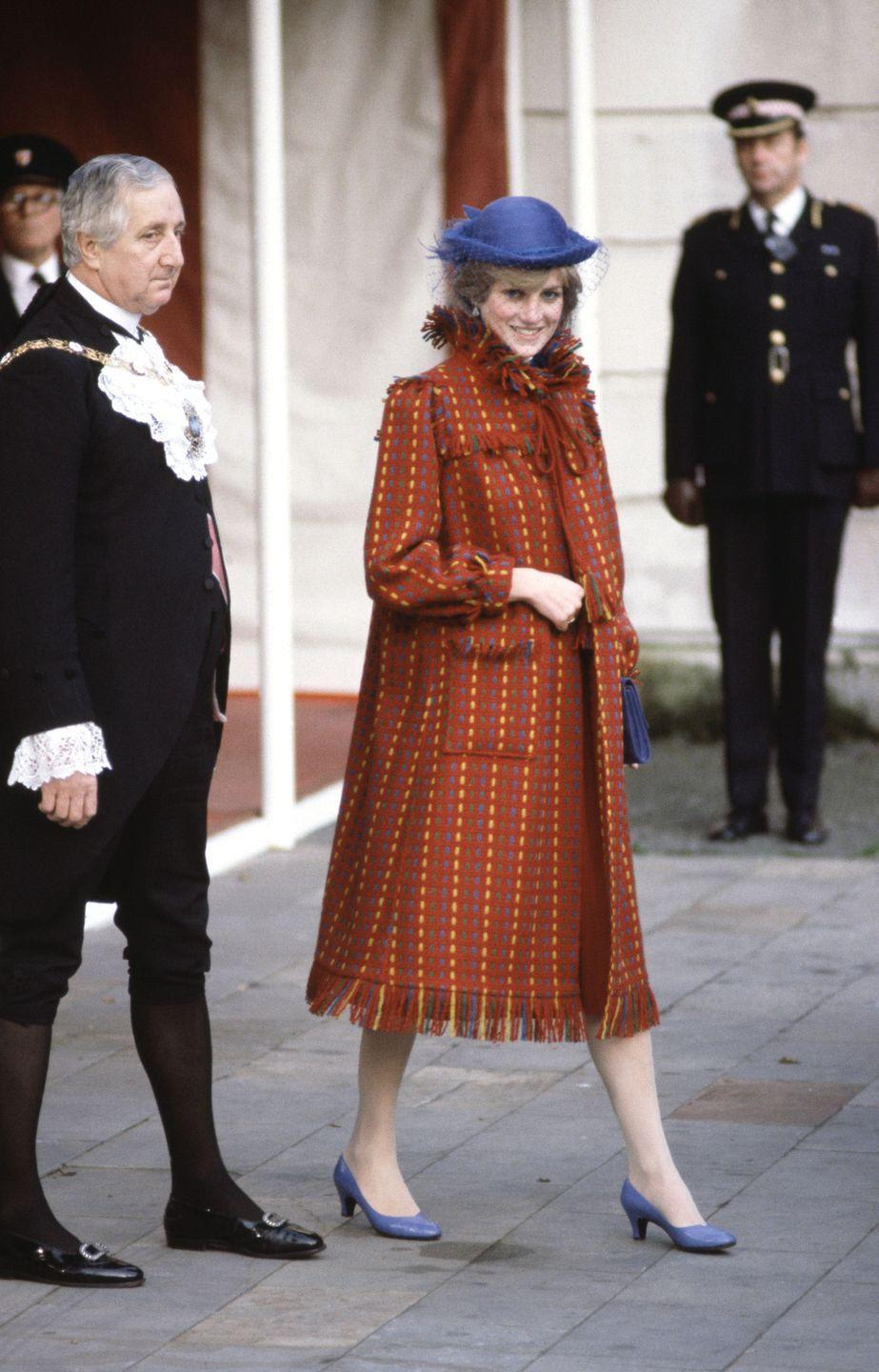 <p>In a fringe-detailed coat, blue hat and matching shoes while visiting the Guildhall in London after announcing her first pregnancy. </p>